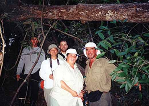 A group taking an Amazon jungle hike after fishing for peacock bass